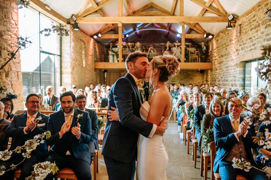 REAL WEDDING - The Simply Beautiful Spring Wedding of Hannah and Phil at Dodford Manor, Captured By GREEN UNION Partner, Ed Brown Photography - first kiss