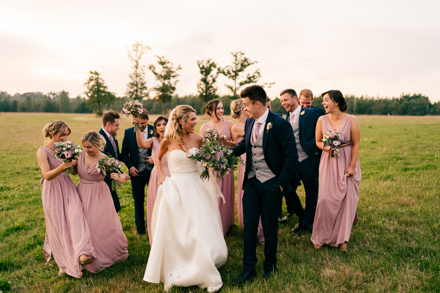 REAL WEDDING - The Eco-Conscious Woodland Wedding Of Emily And Daniel, Captured By Gina Manning Photography At Chaucer Barn, Norfolk - portrait of the bride, groom, bridesmaids and groomsmen