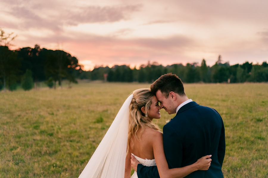 REAL WEDDING - The Eco-Conscious Woodland Wedding Of Emily And Daniel, Captured By Gina Manning Photography At Chaucer Barn, Norfolk - sunset portrait of the bride and groom