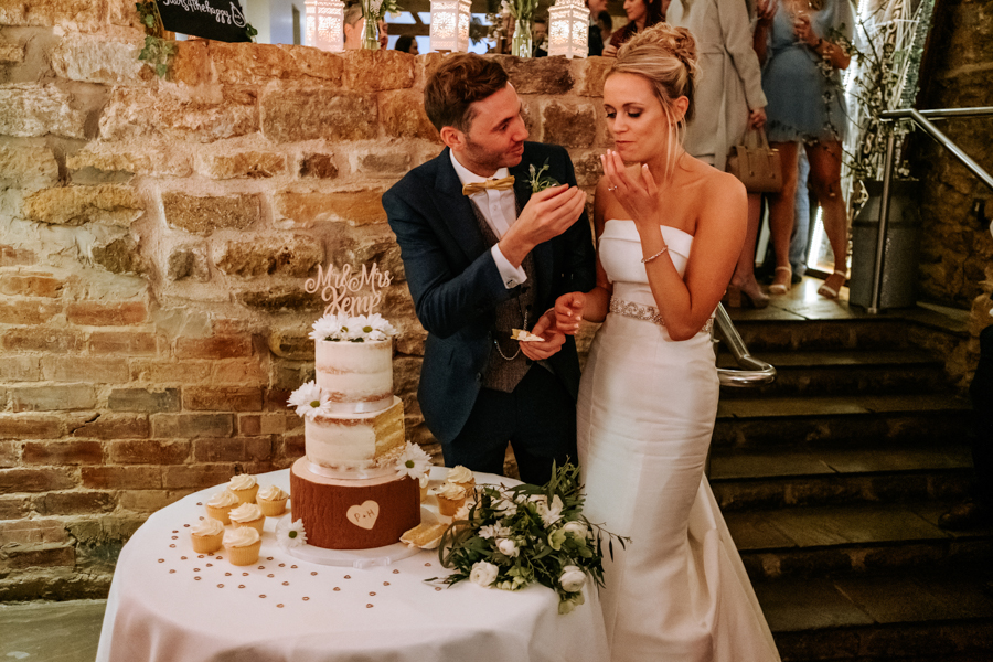 REAL WEDDING - The Simply Beautiful Spring Wedding of Hannah and Phil at Dodford Manor, Captured By GREEN UNION Partner, Ed Brown Photography - cutting the cake