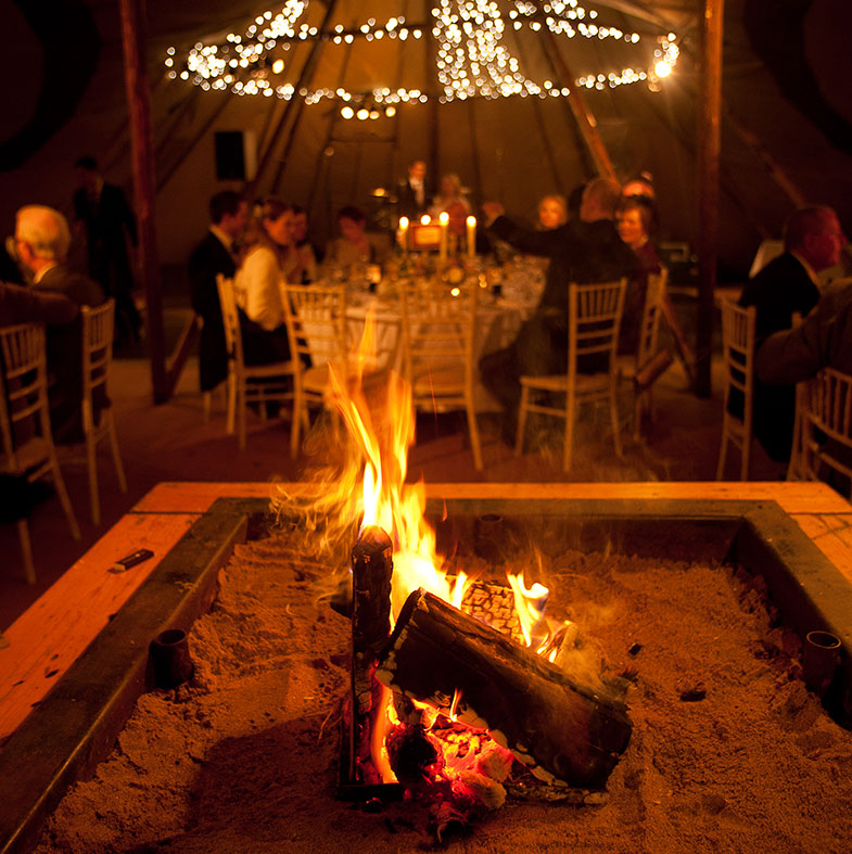 Warm your natural green wedding with log fires on the Winter Solstice