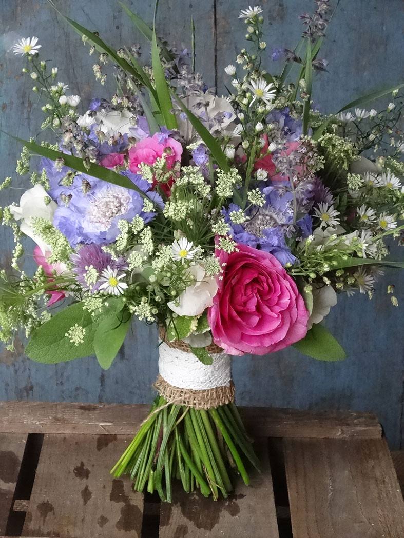 A beautiful wedding bouquet of seasonal flowers in June from Catkin Flowers