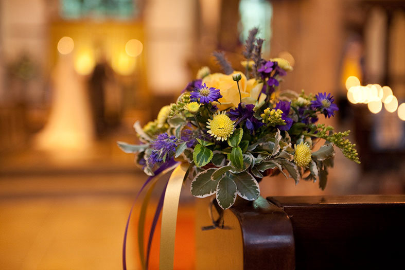 The pew ends in the church are by Organic Blooms