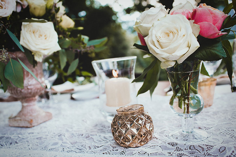 Rustic chic with mercury glass, heiloom roses and antique vessels