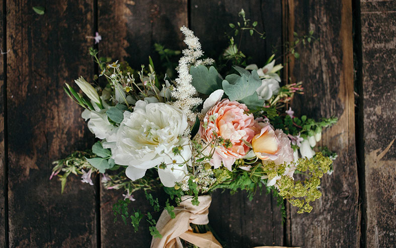 Natural wedding flowers arranged into a bouquet with that just picked look