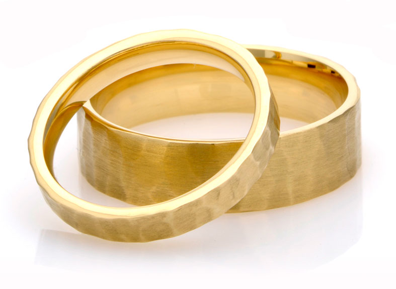 Hammered Fairtrade gold wedding rings by Cred Jewellery