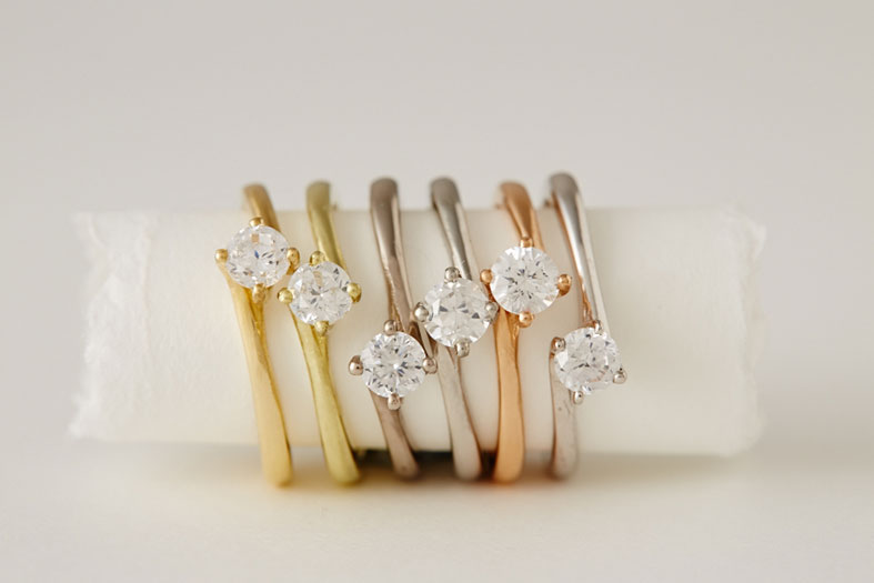 Fairtrade gold solitaires, including one in rose gold by April Doubleday