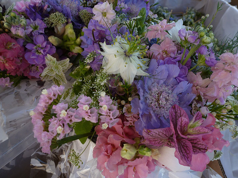 Pink and blue wedding bouquet by Bouquets and Butterflies