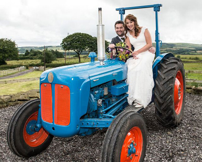 Borrow quirky props like this vintage tractory for your wedding photos