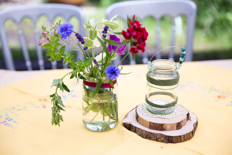 Flowers in recycled jam jars came from our own allotment