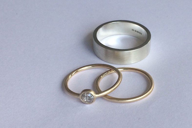 Diamond engagement ring paired with Fairtrade gold wedding rings