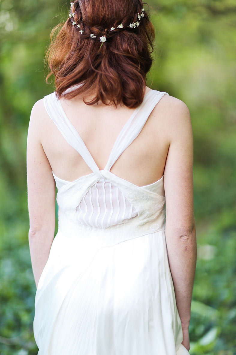 Back details of silk wedding dress and natural hair