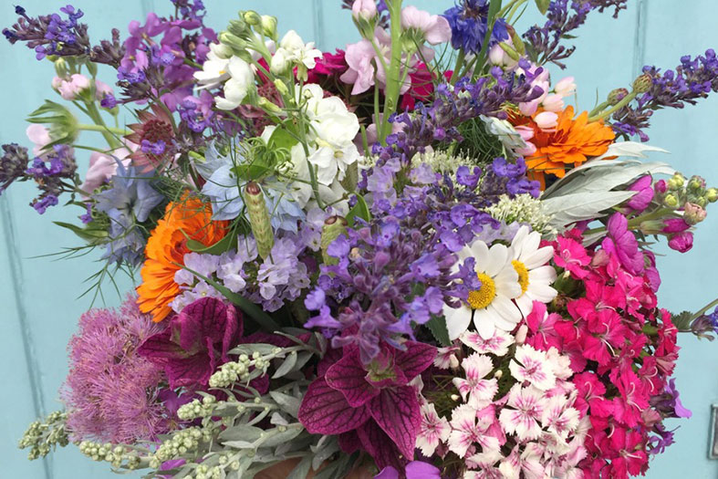 A vibrant wedding bouquet of just picked seasonal British flowers by Bouquets and Butterflies