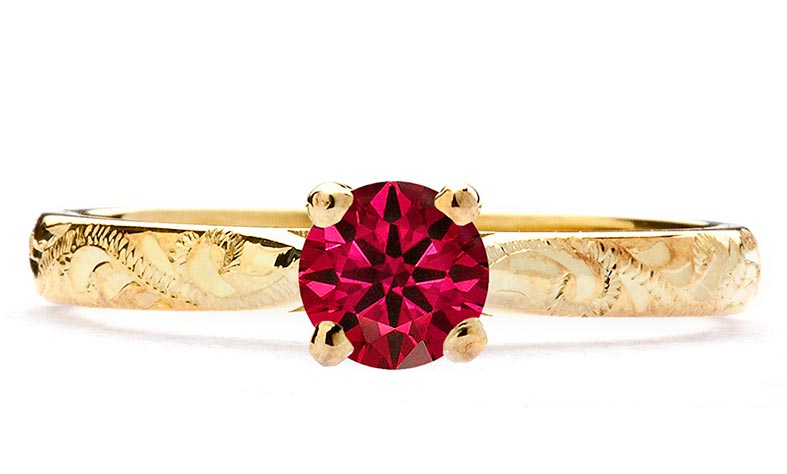 Engraved gold and ruby engagement ring by Arabel Lebrusan
