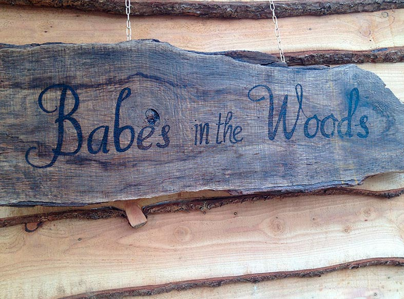 Rustic woodland signage at Babes in the Woods
