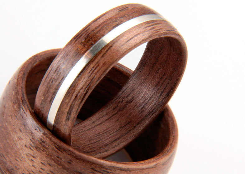His and hers walnut and silver wedding rings