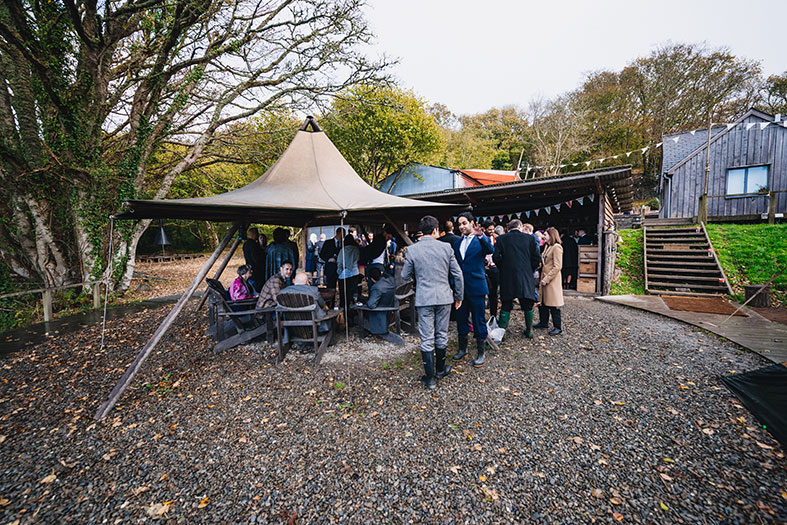Fforest has tipis, fire pits, old stone and wooden outbuildings